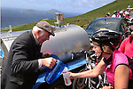Local farmer John Garvey pours water for thirsty cyclists at the top of Coomakista Pass on the Ring of Kerry cycle at the weekend. Over 11,000 cyclists took part in the annual charity event.<br /> Picture by Don MacMonagle
