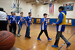 TORRINGTON,  CT-031919JS13- Torrington and Avon Middle School players shake hands following their unified league game Tuesday at Torrington Middle School.  It was the first home game for Torrington. <br /> Jim Shannon Republican American