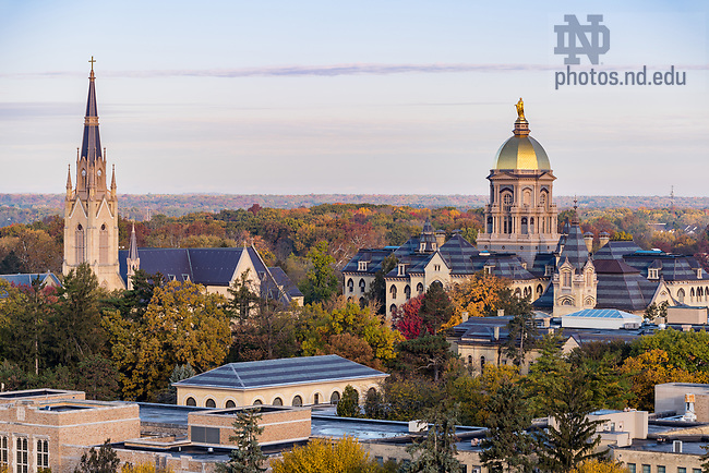 November 7, 2017; Campus at sunrise with the Golden Dome atop the Main Building and the Basilica of the Sacred Heart. (Photo by Barbara Johnston/University of Notre Dame)