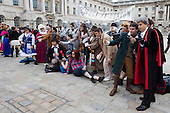 Sci-fi fans pose for a group shot. About 100 Science Fiction fans dressed up as their favourite characters and gathered in the courtyard of Somerset House to head off for the 4th Sci-Fi London Annual Costume Parade. The parade was organised by Sci-Fi London 14, the London International Festival of Science Fiction and Fantastic Film. The film festival runs until 4 May 2014.