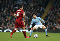 Liverpool's Dejan Lovren under pressure from Manchester City's Leroy Sane<br /> <br /> Photographer Rich Linley/CameraSport<br /> <br /> UEFA Champions League Quarter-Final Second Leg - Manchester City v Liverpool - Tuesday 10th April 2018 - The Etihad - Manchester<br />  <br /> World Copyright &copy; 2017 CameraSport. All rights reserved. 43 Linden Ave. Countesthorpe. Leicester. England. LE8 5PG - Tel: +44 (0) 116 277 4147 - admin@camerasport.com - www.camerasport.com