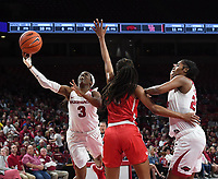 NWA Democrat-Gazette/J.T. WAMPLER Arkansas' Malica Monk takes a shot against Houston Thursday March 21, 2019 at Bud Walton Arena in Fayetteville during the first round of the Women's National Invitational Tournament. Arkansas won 88-80 in overtime. The Razorbacks take on University of Alabama at Birmingham at home on Sunday.