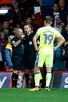 Referee Andy Davies takes advice from his assistant during the Sky Bet Championship match between Brentford and Derby County at Griffin Park, London, England on 26 September 2017. Photo by Carlton Myrie / PRiME Media Images.