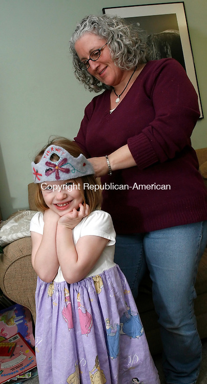 FAIRFIELD, CT, 01/12/08- 011209BZ03- Liz Seaman affixes a hand-made crown on her daughter Tierney Latham, 4, in their Fairfield home Monday.  The crown was made by Stephanie Niles.<br />  Jamison C. Bazinet Republican-American