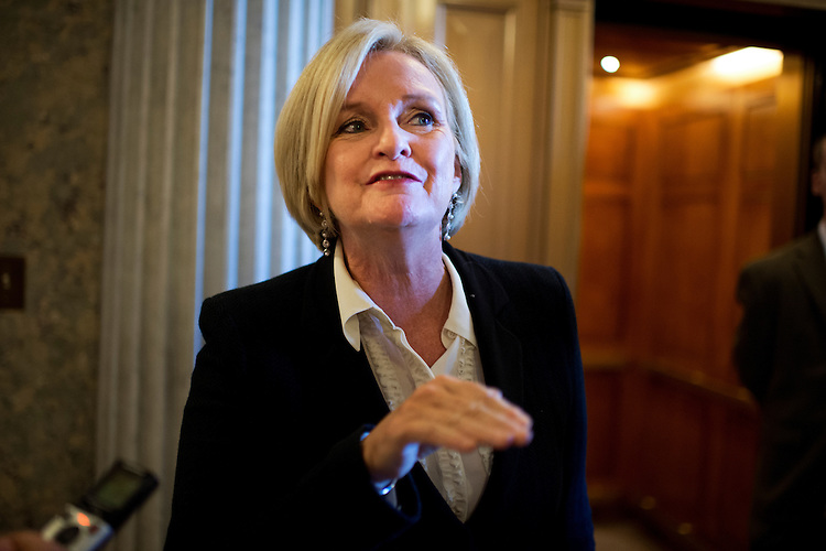 UNITED STATES - SEPTEMBER 25: Sen. Claire McCaskill, D-Mo., talks with reporters outside of the Senate chamber in the Capitol. (Photo By Tom Williams/CQ Roll Call)