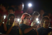 NWA Democrat-Gazette/ANDY SHUPE<br /> Springdale Marching Band members use their cellphone flashlights to read and play music Friday, Sept. 7, 2018, after the stadium lights went out before the start of the Bulldogs' game with Alma at Jarrell Williams Bulldog Stadium in Springdale. Visit nwadg.com/photos to see photographs from the game.