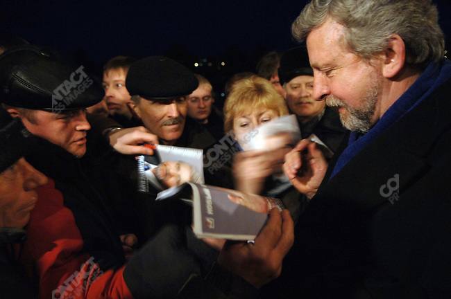 United opposition candidate for the presidential elections in Belarus Alexander Milinkevich signed autographs after he had spoke at a rally in the town of Borisov outside a cinema.