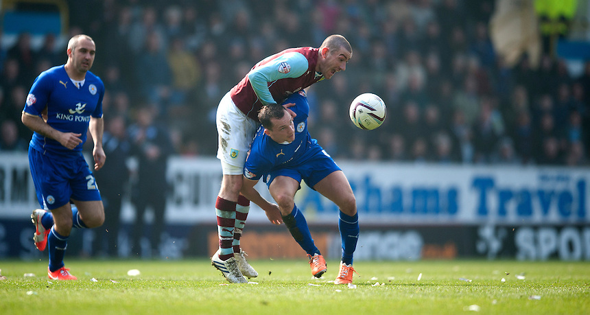 Burnley's David Jones battles with Leicester City's Daniel Drinkwater<br /> <br /> Photo by Stephen White/CameraSport<br /> <br /> Football - The Football League Sky Bet Championship - Burnley v Leicester City - Saturday 29th March 2014 - Turf Moor - Burnley<br /> <br /> &copy; CameraSport - 43 Linden Ave. Countesthorpe. Leicester. England. LE8 5PG - Tel: +44 (0) 116 277 4147 - admin@camerasport.com - www.camerasport.com