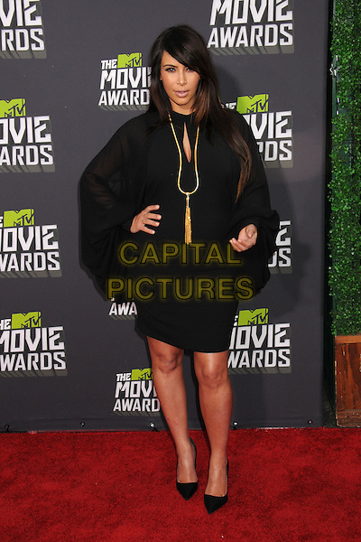 Kim Kardashian.2013 MTV Movie Awards - Arrivals held at Sony Pictures Studios, Culver City, California, USA..14th April  2013.full length black dress  pregnant gold tassel necklace sheer hand on hip.CAP/ADM/BP.©Byron Purvis/AdMedia/Capital Pictures