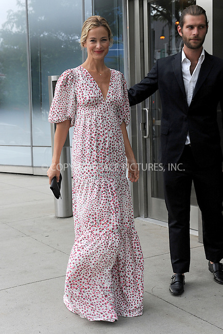 WWW.ACEPIXS.COM<br /> June 3, 2015 New York City<br /> <br /> Carolyn Murphy was seen walking in the Chelsea neighborhood of New York City on June 3, 2015.<br /> <br /> Please byline: Kristin Callahan/AcePictures<br /> <br /> <br /> Tel: (646) 769 0430<br /> e-mail: info@acepixs.com<br /> web: http://www.acepixs.com