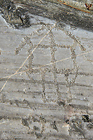Petroglyph, rock carving, depicting a raised houses built on poles . Carved by the ancient Camunni people in the iron age between 1000-1600 BC. Rock no 24,  Foppi di Nadro, Riserva Naturale Incisioni Rupestri di Ceto, Cimbergo e Paspardo, Capo di Ponti, Valcamonica (Val Camonica), Lombardy plain, Italy
