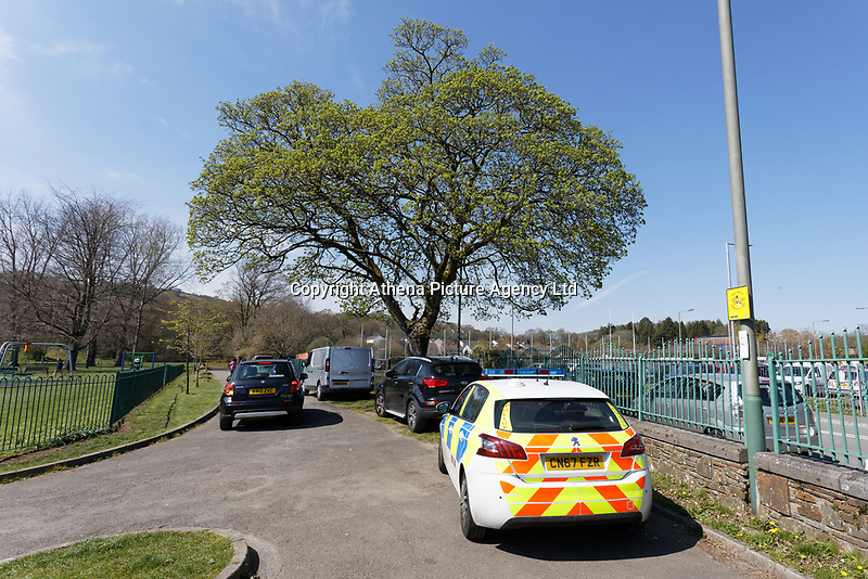 Pictured: Police at Ystrad Mynach Park in south Wales, UK. Saturday 13 April 2019<br /> Re: A 13-year-old boy, named locally as Carson Price,  has died after being found unconscious in Ystrad Mynach Park, Caerphilly County, at about 7.20pm on Friday 12 April.<br /> The teen was taken to University Hospital of Wales in Cardiff where he was pronounced dead.