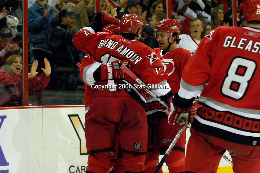 The  Carolina Hurricanes' Ray Whitney, in back, is congratulated by teammates Rod Brind'Amour (17) and Justin Williams, right, after his third period goal during an NHL hockey game against the Boston Bruins Saturday, Dec. 2, 2006 in Raleigh, N.C. Carolina won 5-2.<br />