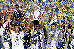 07 December 2014: Landon Donovan (center), with Marcelo Sarvas (BRA) (left) and Robbie Keane (IRL) (right), holds the Philip F. Anschutz Trophy overhead. The Los Angeles Galaxy played the New England Revolution in Carson, California in MLS Cup 2014. Los Angeles won 2-1 in overtime.