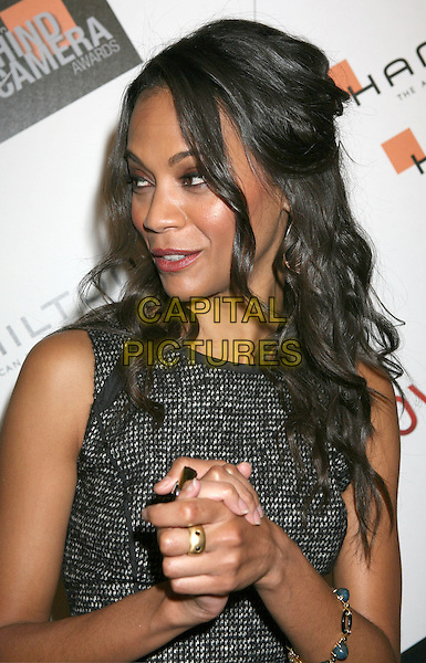 ZOE SALDANA.2009 Hamilton Behind The Camera Awards Presented By Movieline.com at The Highlands, Hollywood, California, USA..November 8th, 2009.half length sleeveless grey gray tweed wool headshot portrait gold ring.CAP/ADM/MJ.©Michael Jade/AdMedia/Capital Pictures.