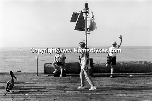 Santa Barbara California . At the end of the pier a man does his morning exercises. 2001