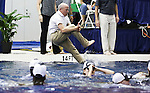 19 MAR 2016: Georgia Head Coach Jack Bauerle leaps into the pool with his team after winning the team championship during the Division I Women's Swimming & Diving Championship held at the Georgia Tech Aquatic Center in Atlanta, GA. Georgia finished with a team score of 414. David Welker/NCAA Photos