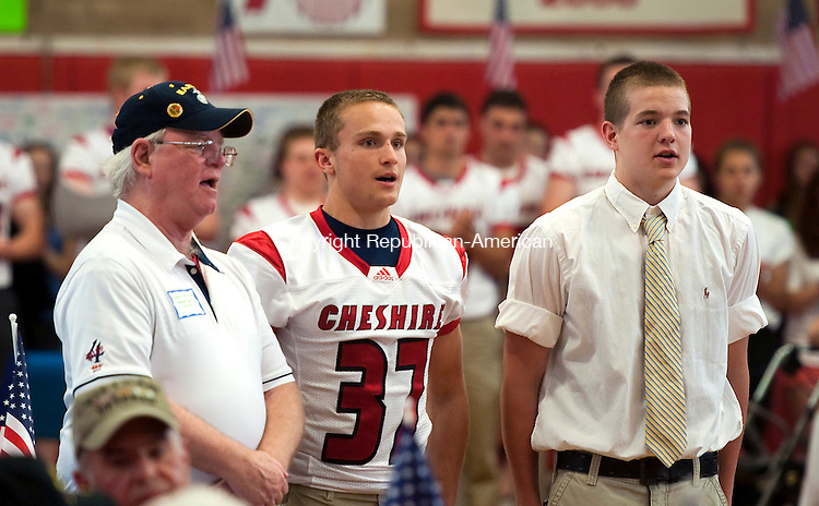 CHESHIRE, CT-052314JS02--U.S. Marine Veteran Rob Griffin, of Waterbury, left, sings the Marines' Hymn with Cheshire High School students Mike Collins, center and grandson Trenton Hager, right, during the annual Cheshire High School's Bring Your Veteran to Lunch Day at the school on Friday. More than 100 veterans attended the event organized by BRAVE, a group of more than 100 students at the high school which stands for Bringing Remembrance to All Veterans Everywhere.  Griffin served in Vietnam in 1972-73. Both Collins and Hager will be joining the United States Marines following graduation. <br /> Jim Shannon Republican-American