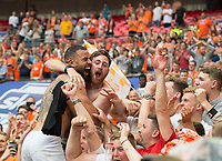 Blackpool Kyle Vassell celebrating with the fans after the Sky Bet League 2 PLAY OFF FINAL match between Exeter City and Blackpool at Wembley Stadium, London, England on 28 May 2017. Photo by Andrew Aleksiejczuk.