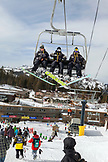 USA, California, Mammoth, Mammoth Ski Resort staff members ride up a chair together
