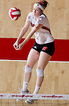 Wisconsin Badgers Annemarie Hickey (4) hits the ball during an NCAA volleyball match against the Michigan Wolverines at the Field House on October 30, 2010 in Madison, Wisconsin. Michigan won the match 3-1. (Photo by David Stluka)