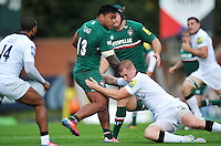 Manu Tuilagi takes on the Newcastle Falcons defence. Aviva Premiership match, between Leicester Tigers and Newcastle Falcons on September 21, 2013 at Welford Road in Leicester, England. Photo by: Patrick Khachfe / JMP