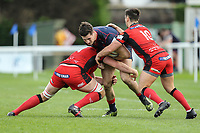 Ross Neal of London Scottish (centre) during the Greene King IPA Championship match between London Scottish Football Club and Hartpury RFC at Richmond Athletic Ground, Richmond, United Kingdom on 28 October 2017. Photo by David Horn.
