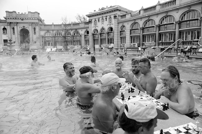 Despite a late winter chill men played chess in the open air at the Szechenyi Thermal Baths in Budapest, Hungary, March 24, 2008