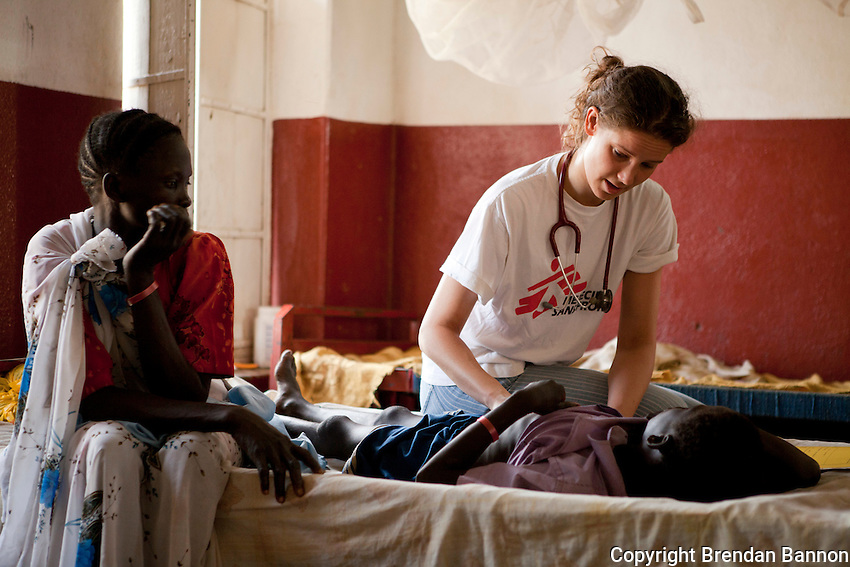 Dr. Florien Oudenaarden examines 11 year old  Kuong Chol  who  was under treatment for gastritus at the MSF hospital in Nasir, South Sudan.