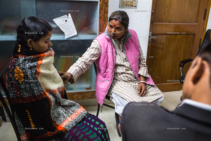Brinda (left) is comforted by Santwana Manju while the Guria legal team prepares her for her final witness court appearance in the Guria office in Varanasi, Uttar Pradesh, India on 22 November 2013. She is one of the 57 underaged and trafficked girls rescued from the Shivdaspur red light area in Varanasi, who has been fighting a court case against her traffickers and brothel owners for the past 8 years.