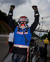 Jun 21, 2015; Bristol, TN, USA; NHRA top fuel driver Richie Crampton celebrates after winning the Thunder Valley Nationals at Bristol Dragway. Mandatory Credit: Mark J. Rebilas-