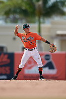 Baltimore Orioles second baseman Rylan Bannon (77) throws to first base during a Florida Instructional League game against the Pittsburgh Pirates on September 22, 2018 at Ed Smith Stadium in Sarasota, Florida.  (Mike Janes/Four Seam Images)