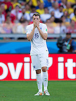 Phil Jones of England looks dejected