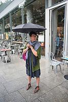 Annuska in the rain, London, England, Great Britain