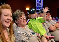 NWA Democrat-Gazette/BEN GOFF -- 04/25/15 Kei Blaylock, 2, waves to his dad, FLW pro Stetson Blaylock of Benton, while watching weigh-ins with his grandmother Julie Blaylock and mother Lindsey Blaylock on day three of the Walmart FLW Tour at Beaver Lake on Saturday Apr. 25, 2015 at the John Q. Hammons Center in Rogers.