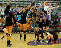 NWA Democrat-Gazette/ANDY SHUPE<br /> Hailey Warner (from left), Abbie Kathol, Olivia Doty, Hadley Spresser and Ella May Powell of Fayetteville celebrate a five-set win over Bentonville Thursday, Sept. 24, 2015, at Fayetteville High. Visit nwadg.com/photos to see more photographs from the match.