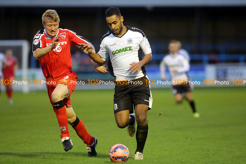 Dover's Stefan Payne in possession as Morecambe's Andy Parrish tries to get back to challenge - Dover Athletic vs Morecambe - FA Challenge Cup 1st Round Football at the Crabble Athletic Ground, Dover, Kent - 08/11/14 - MANDATORY CREDIT: Paul Dennis/TGSPHOTO - Self billing applies where appropriate - contact@tgsphoto.co.uk - NO UNPAID USE