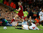 Jordan Henderson of Liverpool tackled by Simon Kjaer of Sevilla during the Champions League Group E match at the Anfield Stadium, Liverpool. Picture date 13th September 2017. Picture credit should read: Simon Bellis/Sportimage