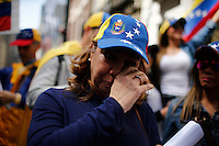 A woman cries while Venezuela's government opposition members take part in a rally against president Maduro and his government in front of Venezuela's consulate in New York,  04/19/2015. Eduardo MunozAlvarez/VIEWpress