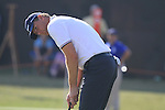 Robert Karlsson takes his putt on the 18th green during Day 1 of the Dubai World Championship, Earth Course, Jumeirah Golf Estates, Dubai, 25th November 2010..(Picture Eoin Clarke/www.golffile.ie)