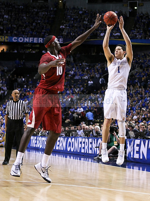 Kentucky guard Devin Booker shoots a three pointer during the first half of the Championship game of the SEC tournament against Arkansas in Nashville , Tenn., on Sunday, March 15, 2015. Photo by Jonathan Krueger | Staff