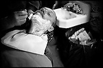 Mark, a man from the neighborhood who has been coming to Mr. Green's for over ten years, gets a shave after weeks of being on the streets again..
