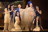 London, UK. 2 March 2016. Anthony Roth Costanzo as Akhnaten and Emma Carrington as Nefertiti with the daughters of Akhnaten. English National Opera (ENO) dress rehearsal of the Philip Glass opera Akhnaten at the London Coliseum. 7 performances from 4  to 18 March 2016. Directed by Phelim McDermott with Anthony Roth Costanzo as Akhnaten, Emma Carrington as Nefertiti, Rebecca Bottone as Queen Tye, James Cleverton as Horemhab, Clive Bayley as Aye, Colin Judson as High Priest of Amon and Zachary James as Scribe. Skills performances by Gandini Juggling.