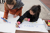 Laila Ozat-McIntyre, 7, of Malden, Mass., (right), and Ayse Yemiscigil, 28, makes signs for the March for Science demonstration in Harvard University's Science Center Plaza in Cambridge, Massachusetts, on Sat., April 22, 2017. Ozat-McIntyre's father is a student at Harvard's Graduate School of Education. Yemiscigil is from Turkey and says she will next year be a Visiting Fellow PhD student studying Behavioral Science at Harvard.