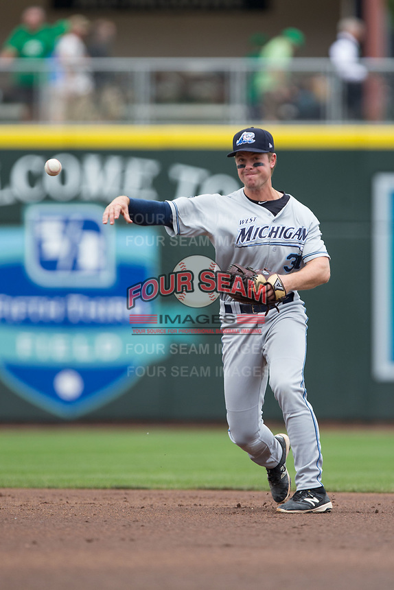 West Michigan Whitecaps second baseman Chad Sedio (31) makes a throw to first base against the Dayton Dragons at Fifth Third Field on May 29, 2017 in Dayton, Ohio.  The Dragons defeated the Whitecaps 4-2.  (Brian Westerholt/Four Seam Images)
