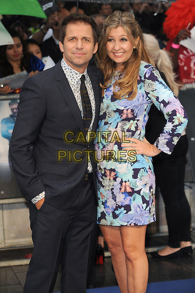 Zack Snyder &amp; Deborah Snyder<br /> 'Man Of Steel' UK film premiere, Empire cinema, Leicester Square, London, England.<br /> 12th June 2013<br /> half length black suit blue pink floral print dress hand on hip married husband wife  <br /> CAP/BEL<br /> &copy;Tom Belcher/Capital Pictures