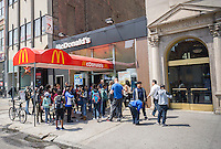 School children in front of a McDonald's restaurant in New York in Union Square on Friday, April 22, 2016.  (© Richard B. Levine)