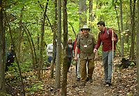 NWA Democrat-Gazette/ANDY SHUPE<br /> Josh Raney (left), director of the University of Arkansas Osher Lifelong Learning Institute, leads a group of hikers Wednesday, Oct. 10, 2018, on a hike on the trails at Gregory Park during a Hikes Near You class in Fayetteville. The group plans hikes at Devil's Den State Park, White Rock, Mount Sequoyah and Hobbs State Park.