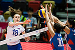 Wing spiker Kseniia Parubets of Russia (L) spikes the ball during the FIVB Volleyball World Grand Prix match between Serbia vs Russia on July 21, 2017 in Hong Kong, China. Photo by Marcio Rodrigo Machado / Power Sport Images