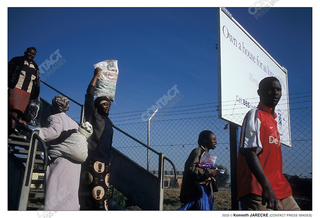 By African standards, the quality of life in Botswana is very good. Francistown, Botswana, September 2003. ..2003 © Kenneth JARECKE (CONTACT Press Images)
